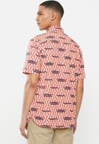 Mami Wata - Crocodile log shirt - red & blue