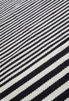 Sixth Floor - Goa woven outdoor rug - natural & black