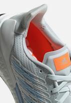 adidas Performance - SolarBOOST ST 19 - blue tint / solar orange