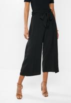 MILLA - Mock wrap pant - black