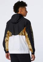 New Balance  - New Balance athletics podium windbreaker - multi