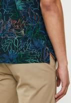 POLO - Floral print custom fit golfer - navy