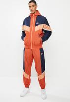 Nike - Nike sportswear he wr+ unld jacket - orange & navy