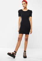 Blake - Ribbed bodycon mini dress - black