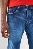 Diesel  - Tepphar slim fit carrot leg jeans - blue