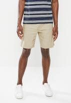 MANGO - Bermuda flek shorts - beige
