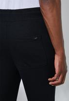 Superbalist - Madrid slim sweatpants - black