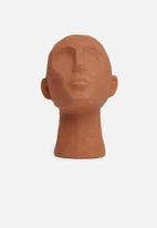 Present Time - Statue face art up - terracotta orange