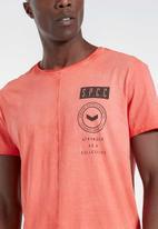 S.P.C.C. - Keats premium stepped hem T-shirt - orange
