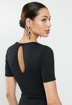 Missguided - Rib short sleeve flare leg jumpsuit - black