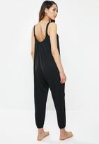 edit - Knit wide leg jumpsuit - black