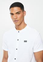 S.P.C.C. - Kent signature button through knit shirt - white