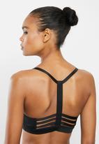 PUMA - Low impact strappy bra - black
