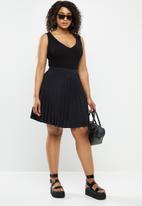 Blake - Satin pleated mini pleated skirt - black