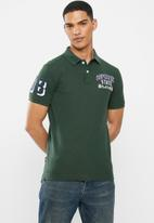 Superdry. - Classic superstate polo - dark forest