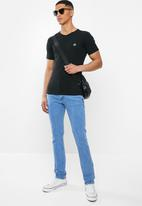 Jonathan D - Slim fit denim jeans with side entry pockets - blue