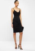 VELVET - Gauged bonbon bodycon midi skirt - black