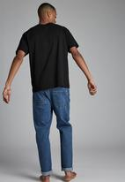 Cotton On - Tapered leg jean - coogee blue