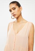 Blake - Crinkle tiered mini dress - peach