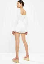 Missguided - Brodierie cut out longsleeve playsuit - white