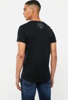 S.P.C.C. - Addle fashion scooped hem T-shirt - black