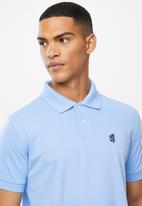 Pringle of Scotland - St Augustine styled golfer - pale blue