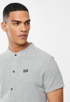 S.P.C.C. - Kent signature button through knit shirt - grey