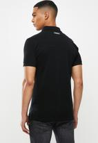 S.P.C.C. - Saxon fashion golfer polo - black