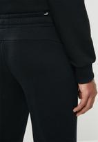 PUMA - Ess logo pants track pants - puma black