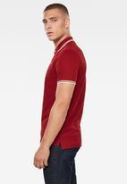 G-Star RAW - Dunda slim stripe polo - dry red