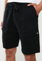 S.P.C.C. - Martial fashion elasticated cargo shorts - black