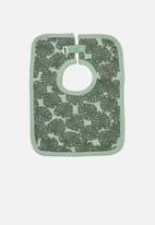 Cotton On - The square bib - smashed avo/tropical leaves
