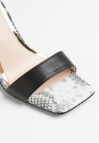 Jada - Ankle strap heel - black