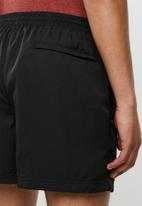 PUMA - Rebel casual woven shorts - puma black