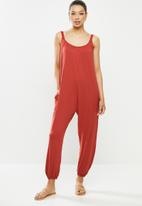 edit - Oversized knit jumpsuit - rust