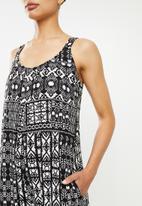 edit - Oversized knit jumpsuit - black aztec