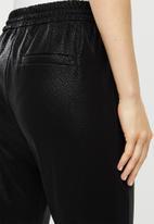 Vero Moda - Eva mr loose string broken coated pant - black
