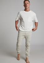 Cotton On - Slim denim jogger - bone