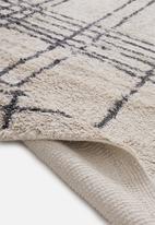 Sixth Floor - Striped tufted rug - charcoal/cream