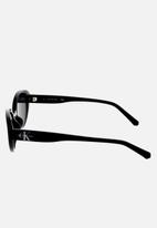 CALVIN KLEIN JEANS - Calvin klein jeans oval sunglasses - black