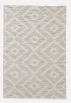 Hertex Fabrics - Bongo rug stream