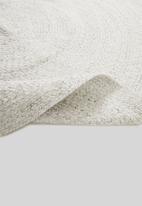 Hertex Fabrics - Swirl woven outdoor rug - vanilla