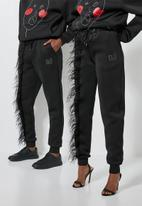 Thebe Magugu extra curricular  x CLD - Thebe Magugu extra curricular  x CLD sweat pants - black