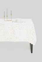 Excellent Housewares - Splatter table cloth - white & gold