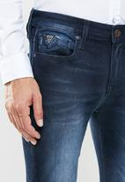 GUESS - Skinny dark wash jeans - blue