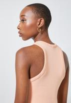 Superbalist - Lycra rib extreme cutaway vest - light pink