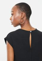 edit - Sleeveless ribbed knit jumpsuit - black