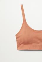 MANGO - Top bra mid impact claudi - light pastel orange