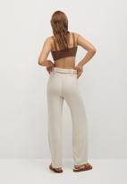 MANGO - Trousers palazzo - neutral