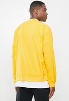 Under Armour - Undrtd woven warmup jacket - yellow